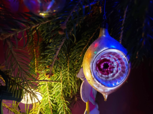 Vintage glass ornament on an evergreen tree